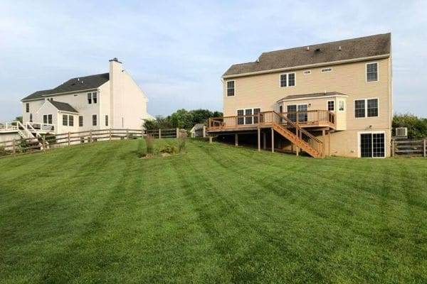 A large yard that has been aerated by Susquehanna Lawn Care.